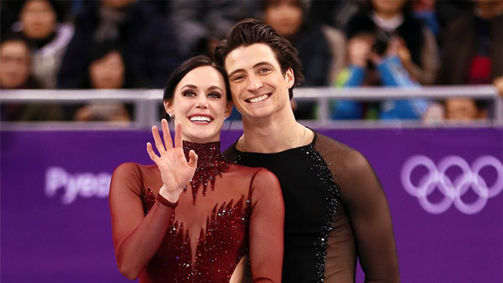tessa and scott at olympics on ice smiling