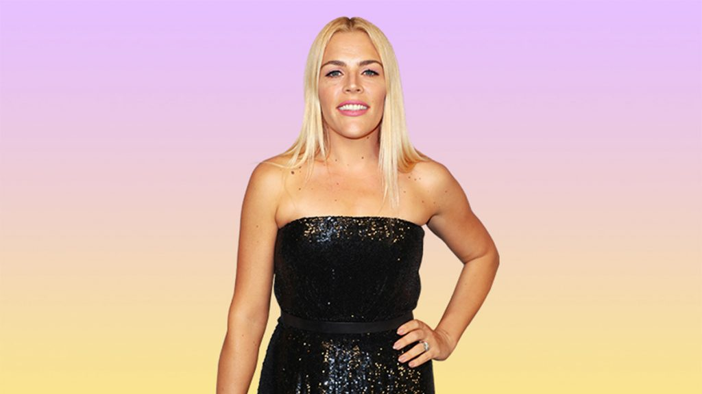 Busy Philipps smiling in black strapless dress