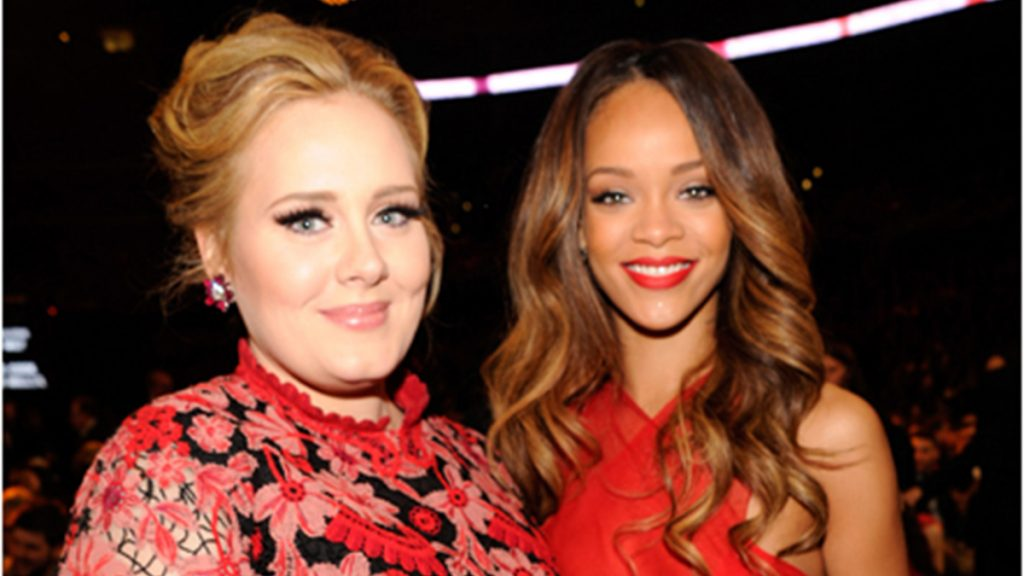 adele with rihanna both wearing red and smiling